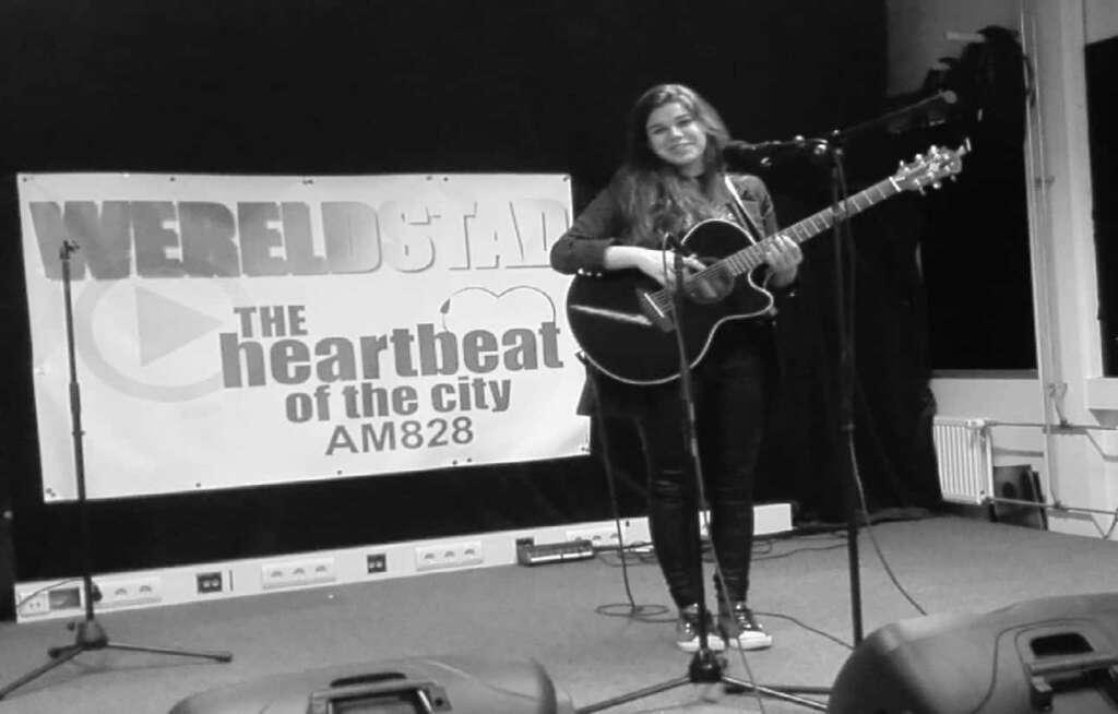 Delise op podium bij Wereldstad Studio